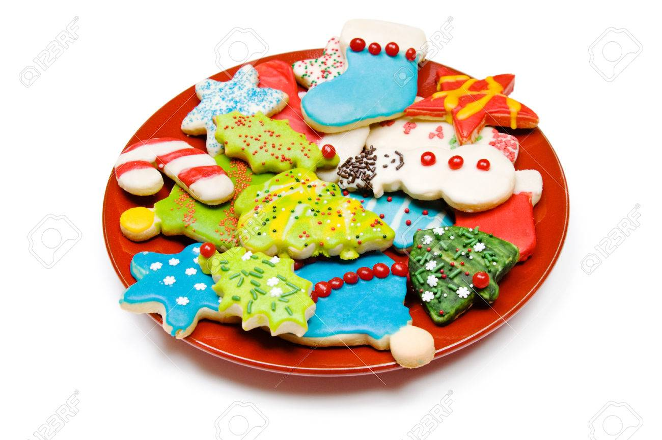 Plate Of Homemade Iced Christmas Sugar Cookies Isolated On White