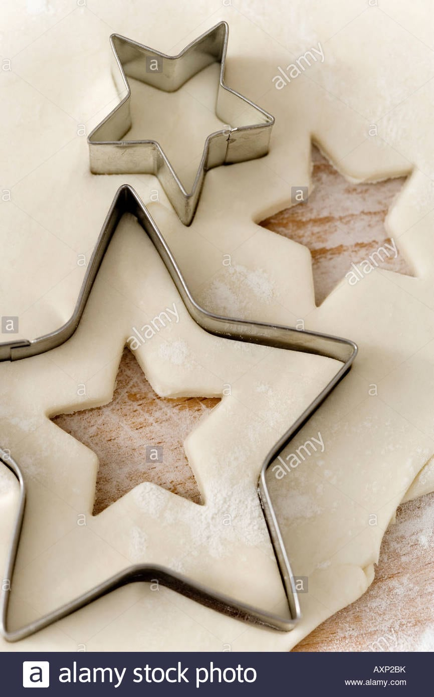 Raw Pastry With Star Shaped Cookie Cutters Stock Photo  16891302