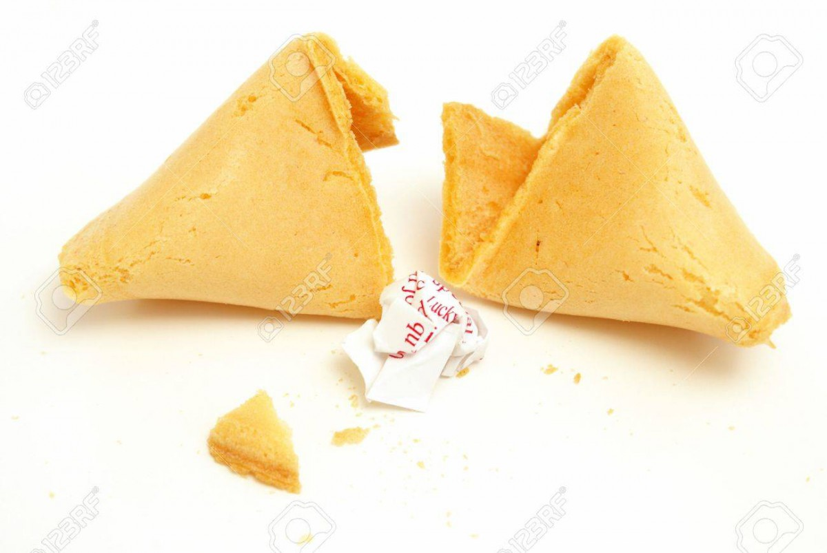 A Fortune Cookie Cracked Open With The Message Crumpled Into