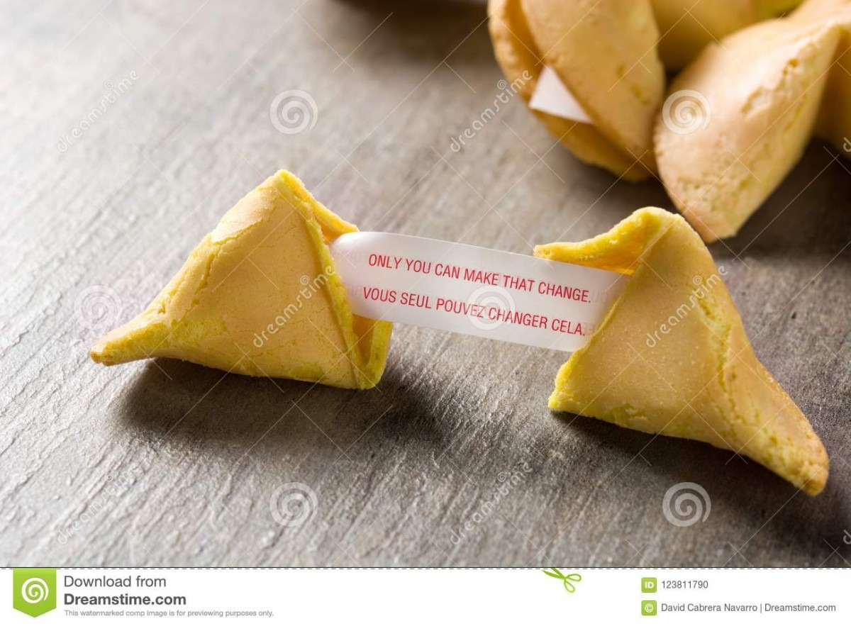 Fortune Cookie With Message On Paper On Wood Stock Photo