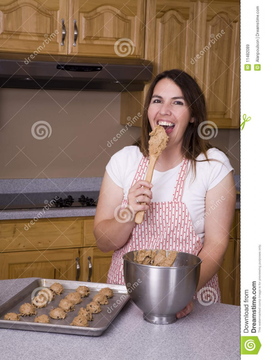 Woman Eating Cookie Dough Stock Image  Image Of Eating