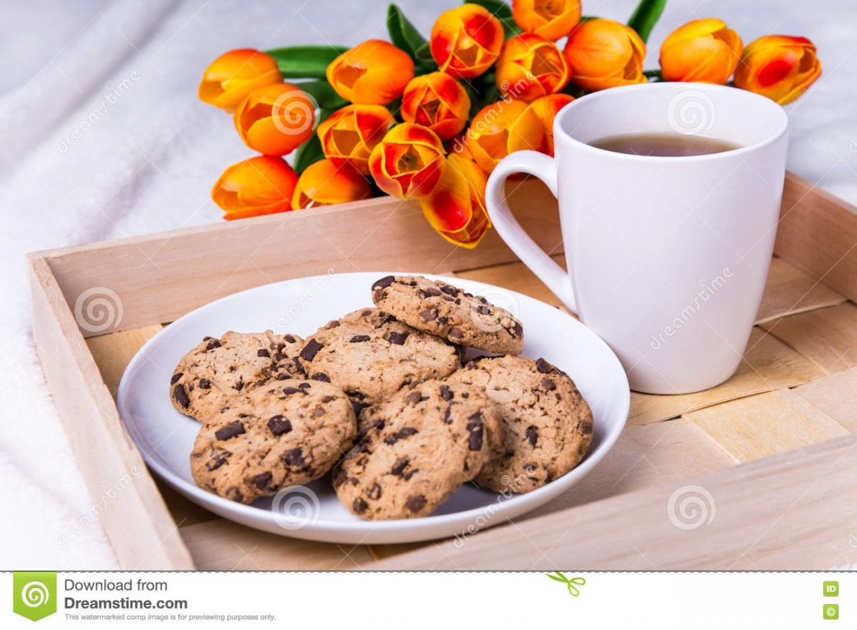 Wooden Tray With Chocolate Chip Cookies And Cup Of Tea Stock Photo