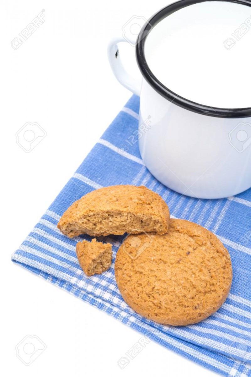 Oatmeal Cookies And Enamel Mug Of Milk Isolated On White Stock
