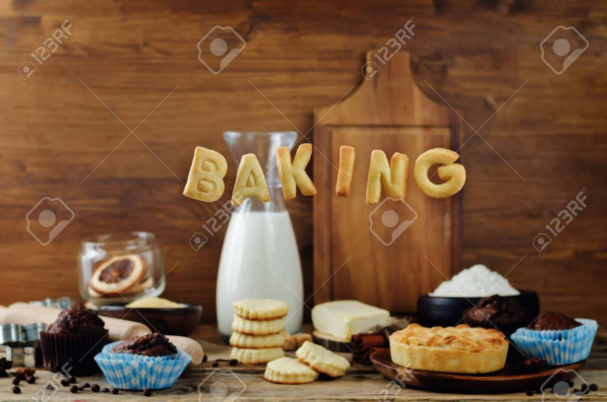 Baking Word Cookies With Ingredients And Baking Tools On A Wood