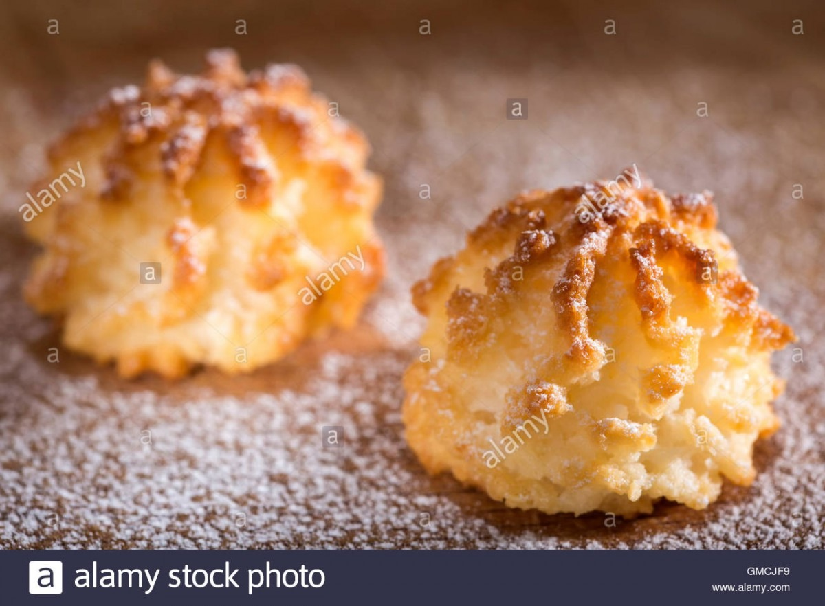 Coconut Macaroons Christmas Cookies With Powdered Sugar On Wooden