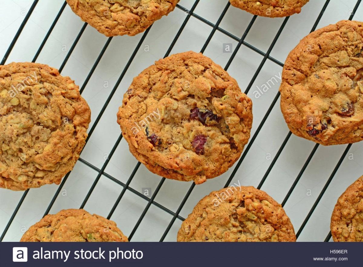 Fresh Baked Oatmeal Raisin Walnut Cookies On Black Cooling Rack