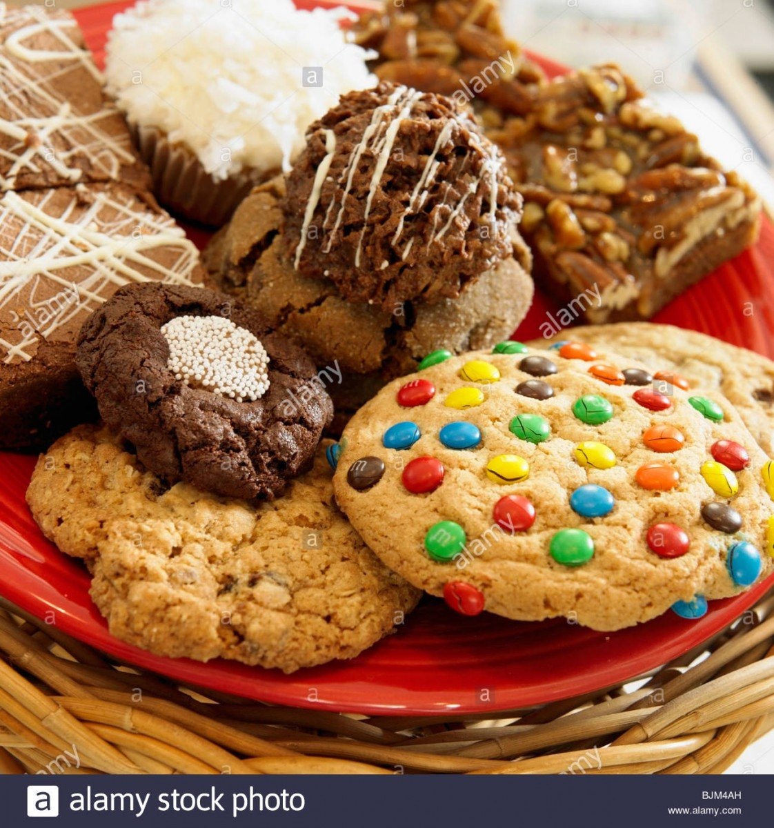 Variety Of Cookies On A Red Plate Stock Photo  28716649
