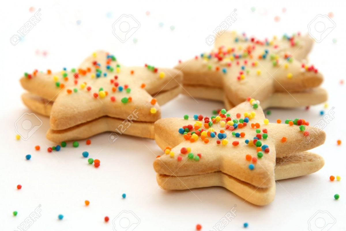 Star Shaped Cookies Decorated With Colorful Toppings Stock Photo