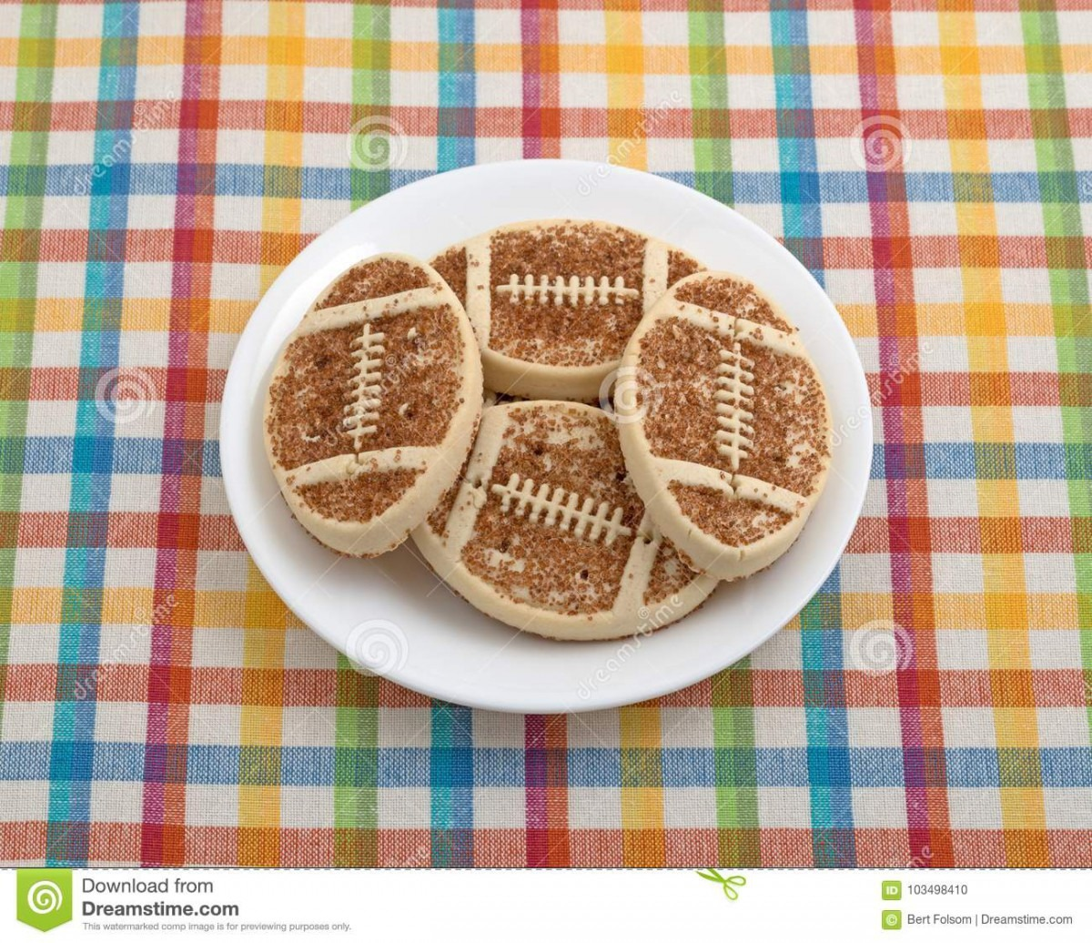 Football Shaped Sugar Cookies On A Plate Stock Photo