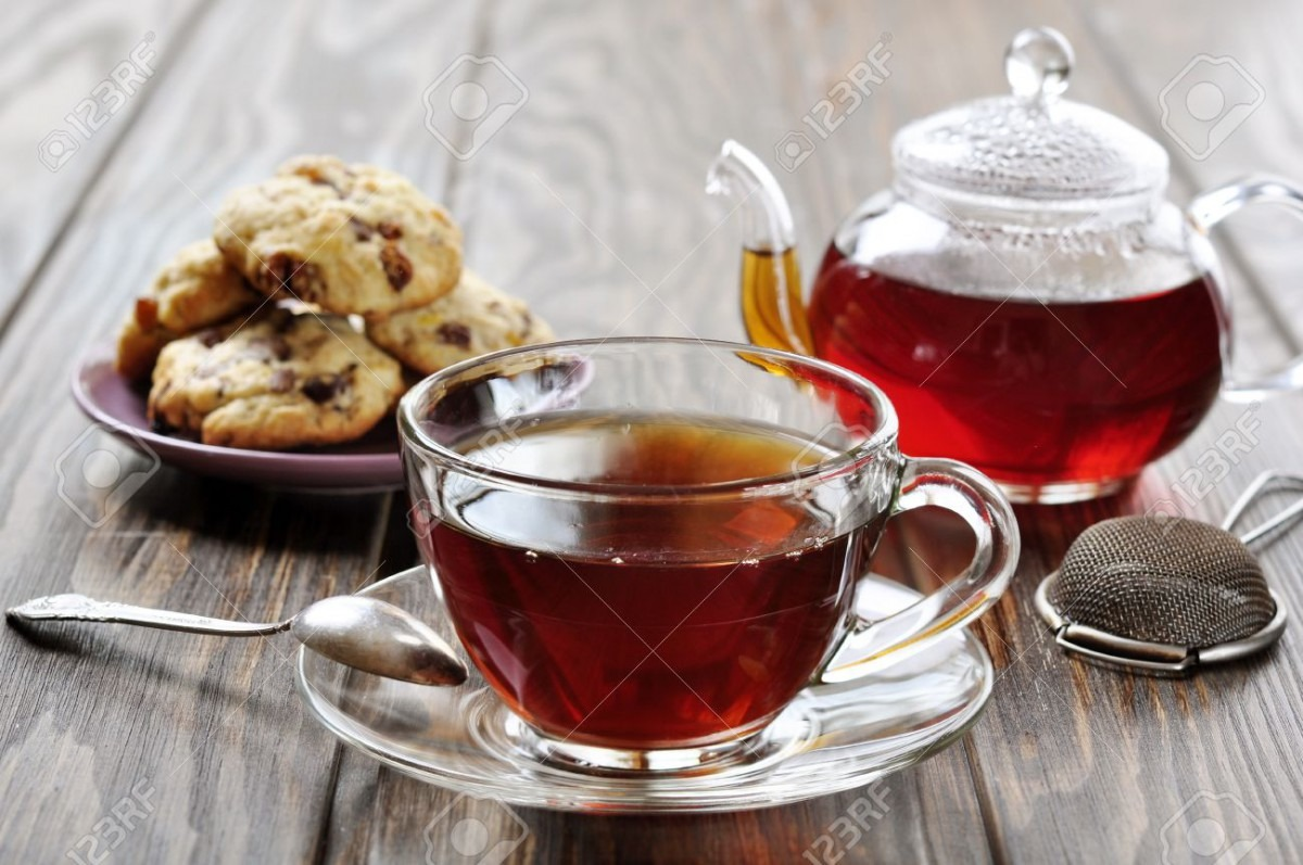 Cup Of Tea With Teapot And Cookies On Wooden Background Stock