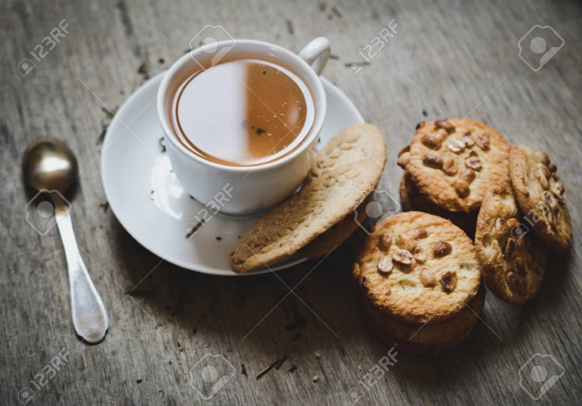 Hot Tea And Cookies On The Desk Stock Photo, Picture And Royalty