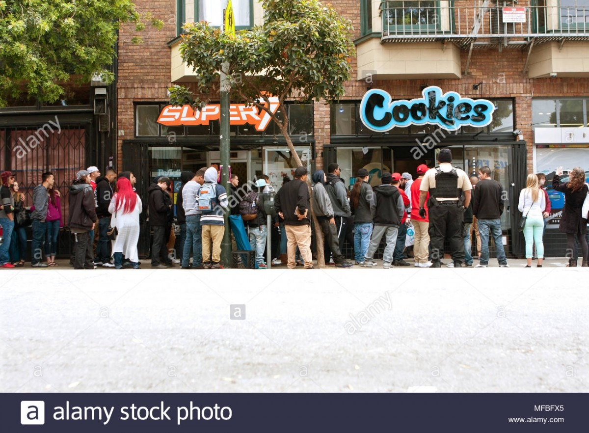 A Very Long Line Of People Waits To Get Into A New Cookies Store