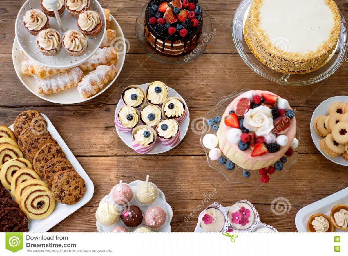 Table With Cakes, Cookies, Cupcakes, Tarts And Cakepops  Stock