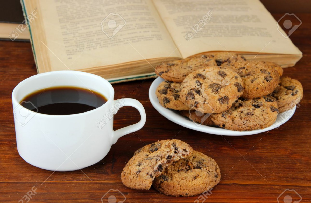 Cup Of Coffee With Cookies And Books On Wooden Stock Photo