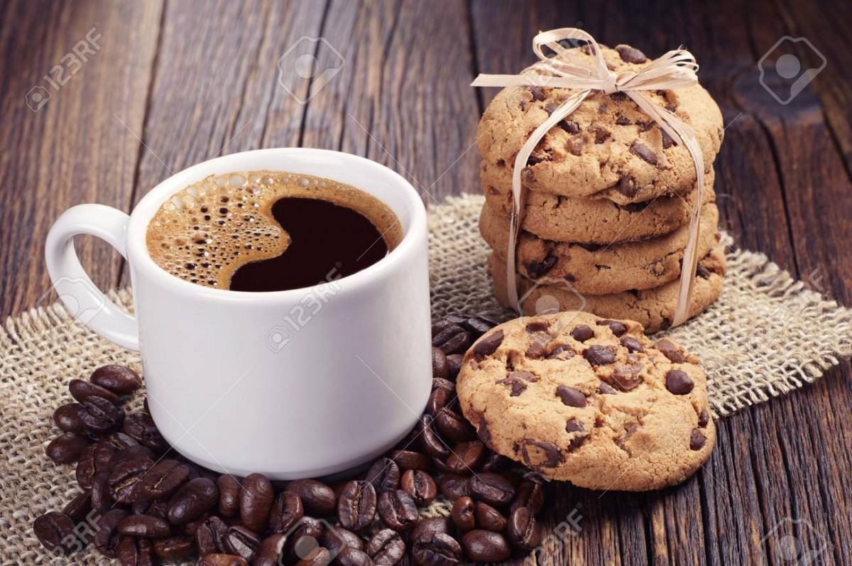 Cup Of Hot Coffee And Cookies Tied With A Ribbon On Dark Wooden