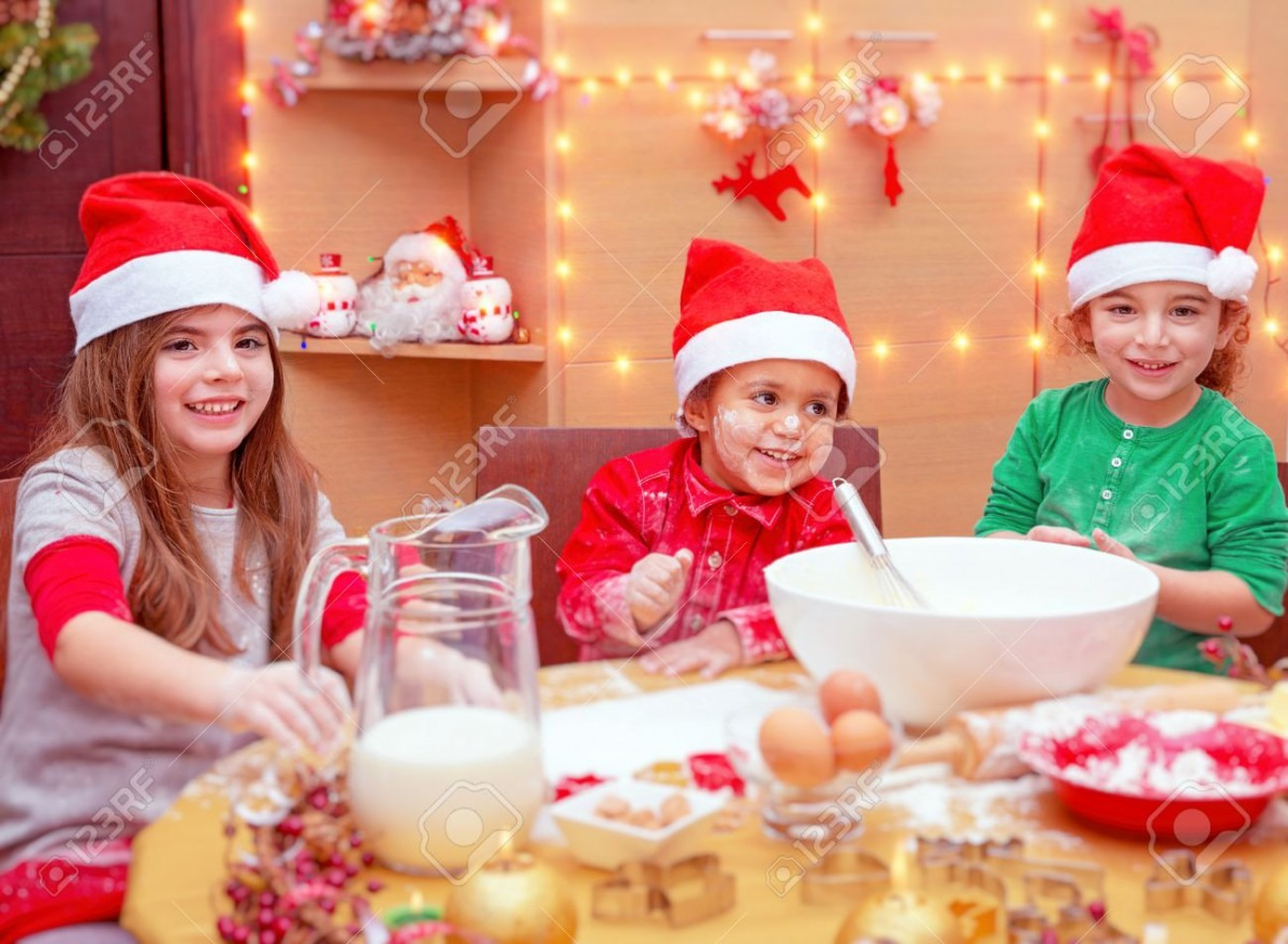 Happy Children Making Christmas Cookies At Home, Three Cute Little
