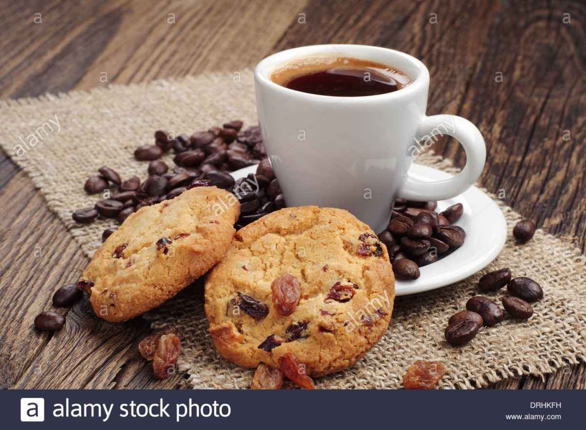 Cup Of Coffee And Cookies With Raisins And Coffee Beans On Coarse