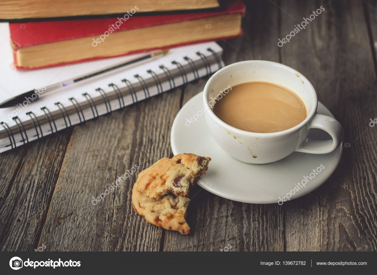 Stack Of Book And Cookies With Hot Coffee On Dirty Cup On Wood B